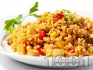 Рецепта Пържен задушен ориз с пилешки хапки, зеленчуци и соев сос